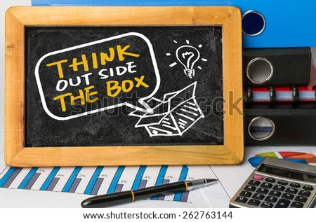 think outside the box concept hand drawing on blackboard - stock photo