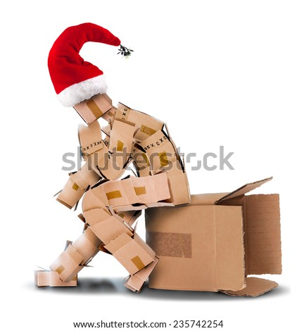 Think outside the box concept on a white background with a Christmas hat - stock photo