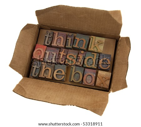think outside the box concept, words  in vintage letterpress type  in open cardboard box, isolated on white