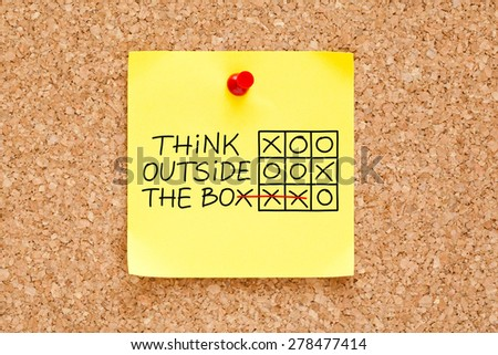 Think Outside The Box tic-tac-toe game concept on yellow sticky note. - stock photo