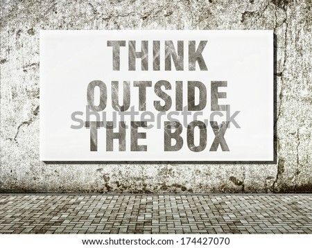Think outside the box, words on old wall - stock photo