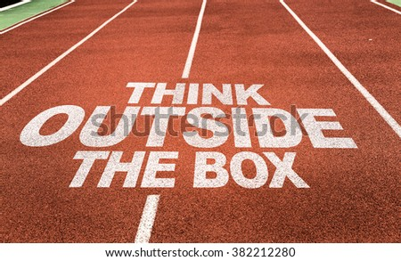 Think Outside the Box written on running track - stock photo