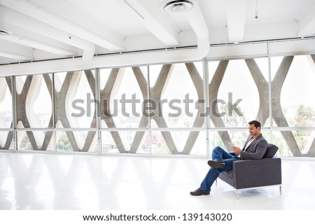 think padAttractive business man in his 20s working on a think pad. - stock photo