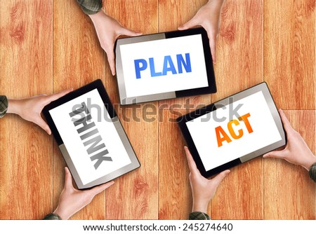 Think Plan Act Business Concept with Coworkers Hands holding Digital Tablet Computers. - stock photo