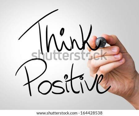 Think Positive hand writing with a black mark on a transparent board - stock photo