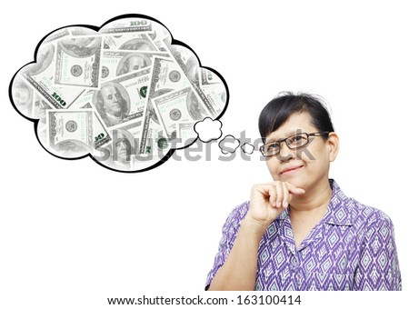 Thinking Asia woman looking up on bubble of money stack