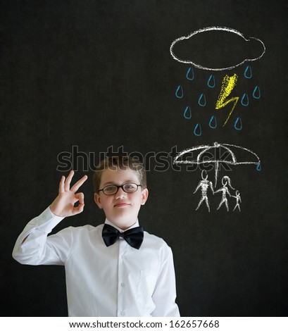 Thinking boy dressed up as business man thinking about protecting family from natural disaster on blackboard background - stock photo