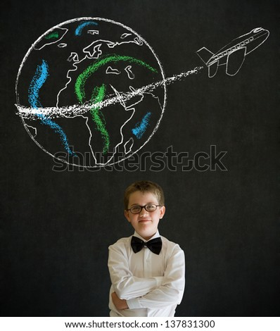 Thinking boy dressed up as business man with chalk globe and jet world travel on blackboard background - stock photo