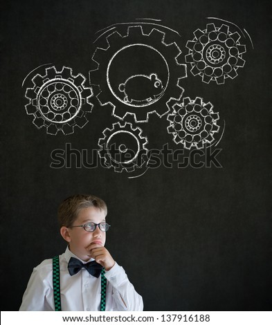 Thinking boy dressed up as business man with chalk turning gear cogs and running hamster on blackboard background - stock photo