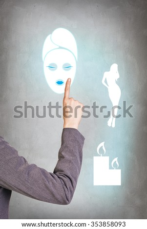 Thinking business woman on gray background with finger at face