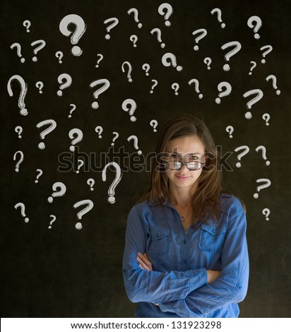 Thinking business woman with chalk questions marks on blackboard background