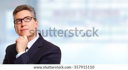 Thinking businessman. - stock photo