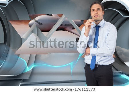 Thinking businessman biting glasses against abstract design in blue