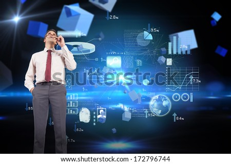 Thinking businessman holding glasses against boxes on technical background