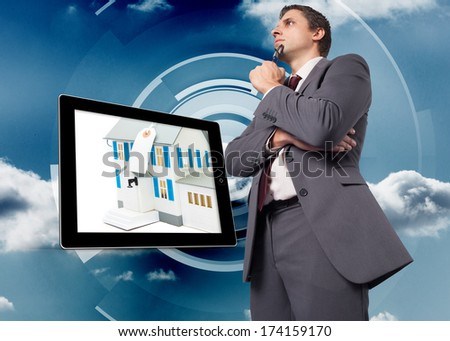 Thinking businessman holding his glasses against cloud on a futuristic structure