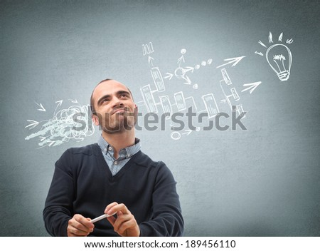 Thinking businessman planning his business structure - stock photo