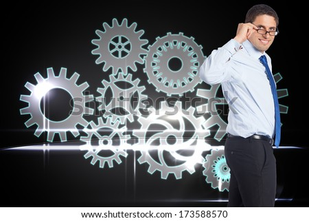 Thinking businessman tilting glasses against train tracks leading over the cloudy horizon - stock photo