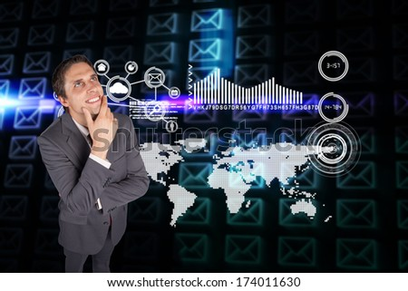 Thinking businessman touching his chin against glowing envelopes on black background