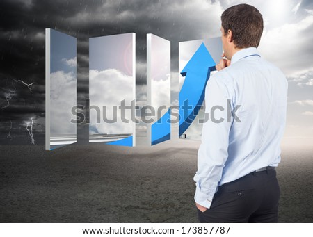 Thinking businessman touching his chin against ominous landscape