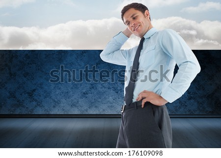 Thinking businessman with hand on head against balcony and bright sky