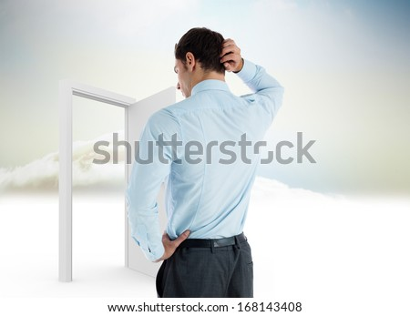 Thinking businessman with hand on head against open door in sky