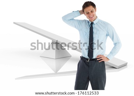 Thinking businessman with hand on head against white scales