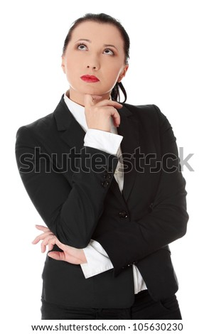 Thinking businesswoman wears black suit. Isolated on the white background. - stock photo