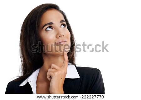 Thinking businesswoman with idea looking upward - stock photo