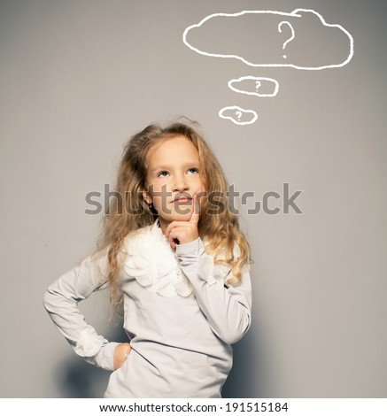 Thinking child. Portrait girl looking up - stock photo