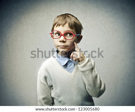 Thinking child with red glasses