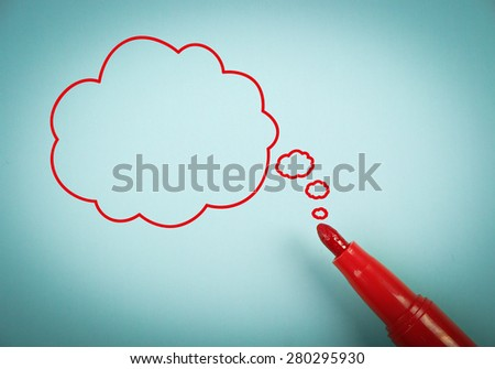 Thinking concept is on blue paper with a red marker aside. - stock photo