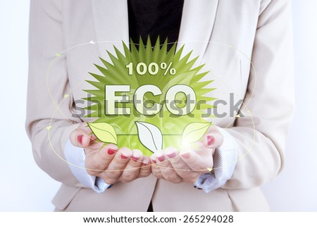 Thinking ECO symbol in woman hands. - stock photo