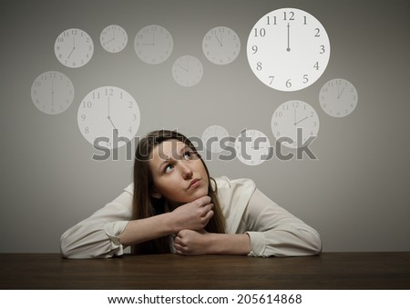 Thinking. Girl full of doubts and hesitation. Time concept. - stock photo