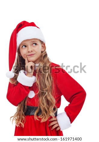 Thinking girl in christmas outfit - holiday related dilemma concept, isolated - stock photo