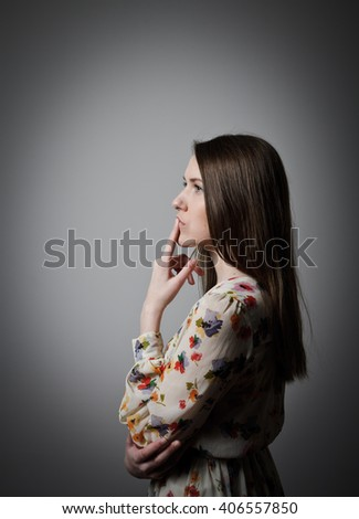 Thinking. Girl is full of doubts and hesitation - stock photo