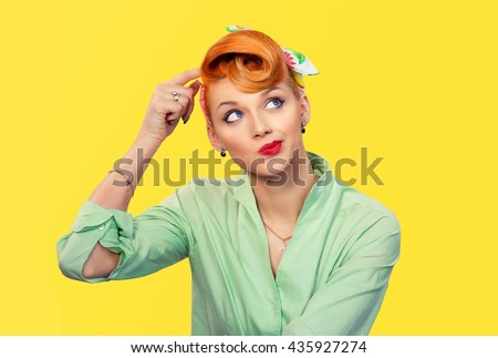 Thinking girl. Portrait closeup funny confused skeptical woman girl female thinking trying to recall looking upwards isolated yellow wall background. Human expressions emotions feelings body language - stock photo