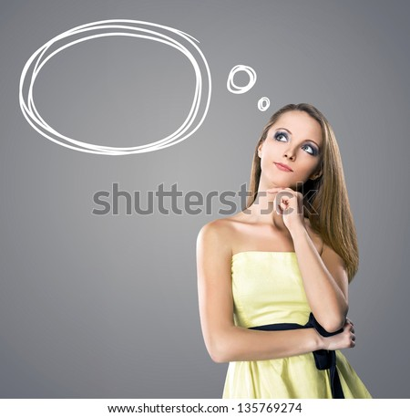 Thinking girl with a hand-drawn bubble - stock photo
