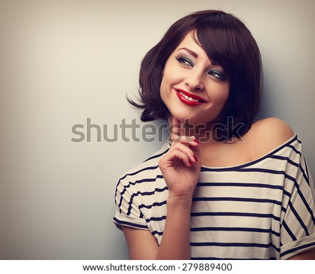 Thinking happy young modern woman looking on copy space. Closeup vintage portrait