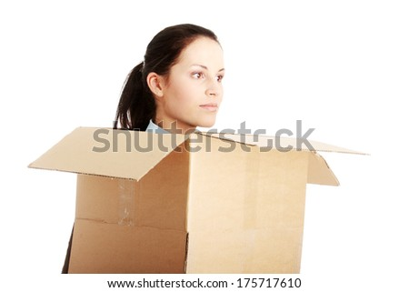 Thinking inside a box. Young business woman in cardboard box, isolated on white