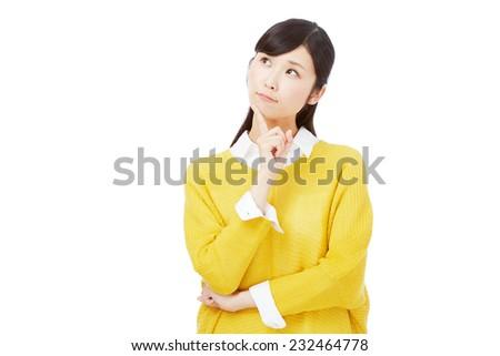 thinking Japanese woman - stock photo