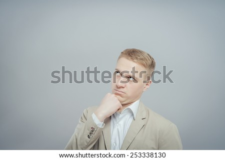 Thinking man . Closeup portrait of a casual young pensive businessman looking up at  - stock photo