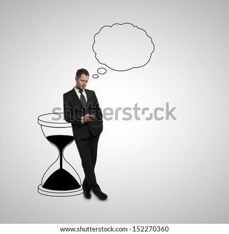 thinking man standing with sand clock