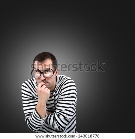 Thinking man, studio portrait - stock photo
