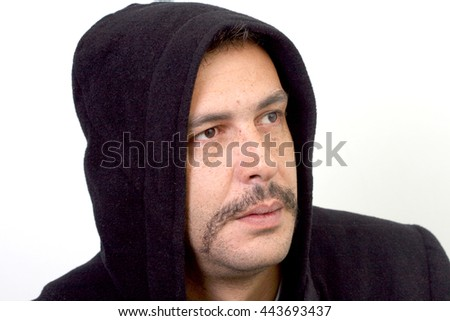 Thinking  man with  mustaches wearing hooded jumper.