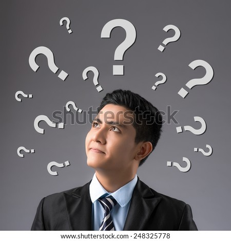 thinking man with question mark on white background. man with questions symbol overhead - stock photo