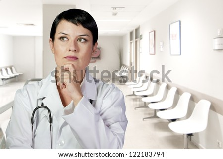 Thinking medical doctor thinking looking up smiling, Medical woman in the office, diagnosis - stock photo