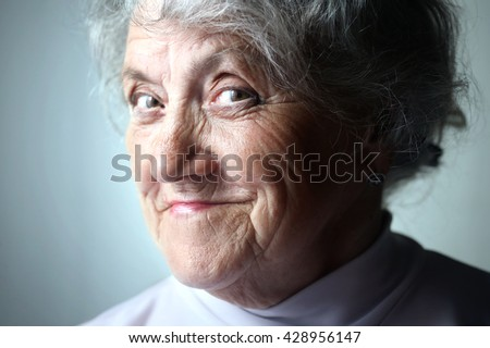 Thinking old woman portrait on a blue background