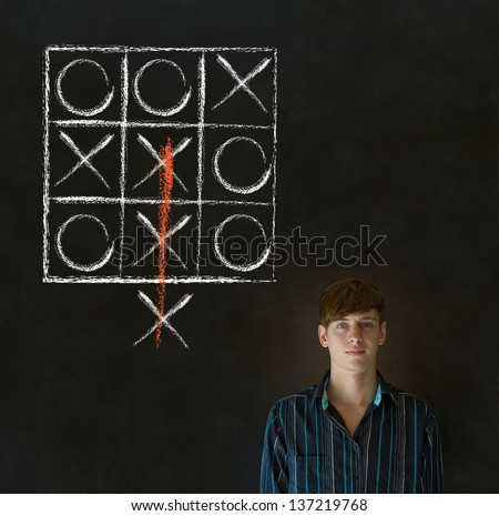Thinking out of the box businessman, student or teacher tic tac toe on blackboard background - stock photo
