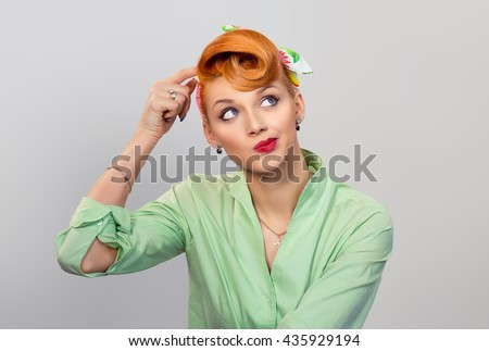 Thinking. Portrait closeup funny confused skeptical woman girl female thinking remembering things  looking upwards isolated grey gray wall background. Human expressions emotions feelings body language - stock photo