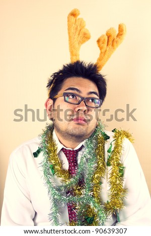 Thinking Reindeer, Businessman with reindeer horn act thinking.